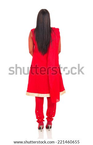 back view of indian woman in traditional clothes isolated on white background - stock photo