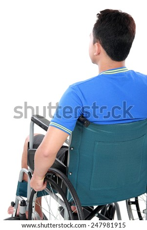 back view of injured man in wheelchair - stock photo