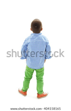 Back view of little boy looking at wall. Rear view. Isolated on white background  - stock photo
