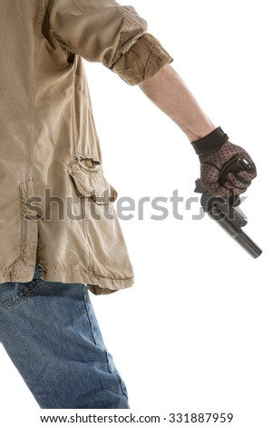 Back view of man in black glove with a gun in hand isolated on white background - stock photo
