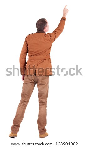 Back view of  man in jacket  pointing. Young handsome guy in jeans and  jacket showing. Rear view people collection.  backside view of person.  Isolated over white background. - stock photo