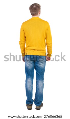 Back view of man in jeans. Standing young guy. Rear view people collection.  backside view of person.  Isolated over white background. The guy in the yellow jacket is hands down along the body. - stock photo
