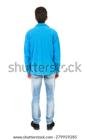 Back view of man in jeans. Standing young guy. Rear view people collection.  backside view of person.  Isolated over white background.  The guy in the blue sweater looking straight ahead .. - stock photo