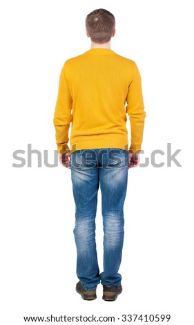 Back view of man in jeans. Standing young guy. Rear view people collection.  backside view of person.  Isolated over white background. the guy in the yellow jersey is exactly with her hands - stock photo