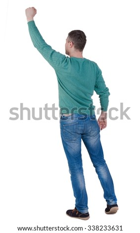 Back view of  man.  Raised his fist up in victory sign.   Rear view people collection.  backside view of person.  Isolated over white background. - stock photo