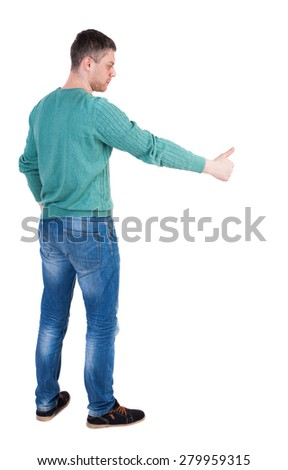 Back view of  man thumbs up. Rear view people collection. backside view of person. Isolated over white background.  The guy in the green jacket stands sideways and shows thumb down right - stock photo
