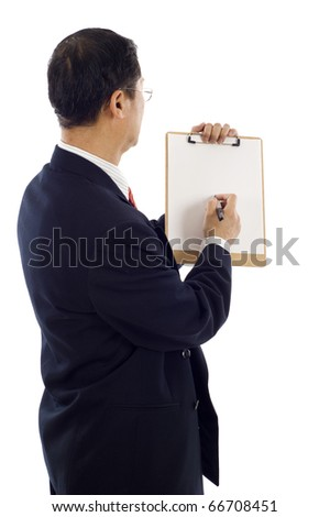 Back view of mature Asian businessman writing on a clipboard isolated over white background - stock photo