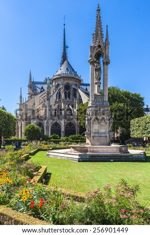 Back view of Notre Dame in Paris, France - stock photo