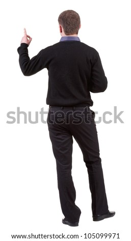 Back view of pointing business man. gesticulating young guy in black suit. Rear view people collection.  backside view of person.  Isolated over white background. - stock photo