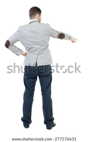 Back view of pointing business man. gesticulating young guy in black suit. Rear view people collection.  backside view of person.  Isolated over white background. Businessman points finger down