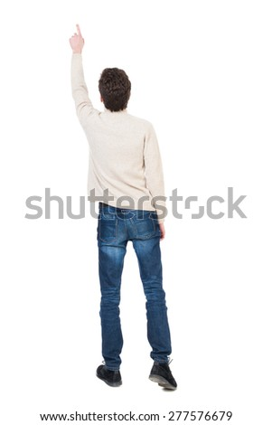Back view of pointing business man. gesticulating young guy in black suit. Rear view people collection.  backside view of person.   The man saw something high up. - stock photo