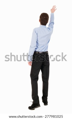 Back view of pointing business man. gesticulating young guy in black suit. Rear view people collection.  backside view person. Isolated over white background. Businessman accompanies departing plane - stock photo
