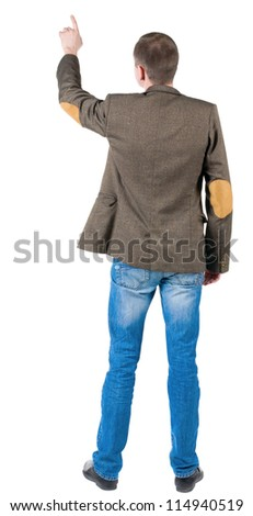 Back view of pointing business man  . gesticulating young guy suit jacket with patches on the sleeves. Rear view people collection.  backside view of person.  Isolated over white background. - stock photo