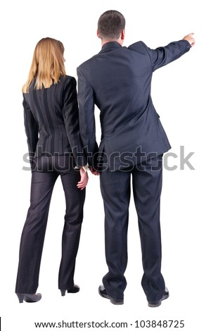 Back view of pointing business team. young couple (man and woman) . beautiful girl and guy in suit together. Rear view people collection. backside view of person. Isolated over white background - stock photo