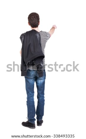 Back view of pointing man in winter jacket  looking up.   Standing young guy in parka. Rear view people collection.  backside view of person.  Isolated over white background.  - stock photo