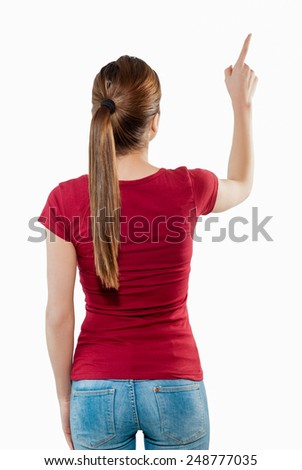 Back view of pointing woman. Backside view of person. Isolated over white background. - stock photo