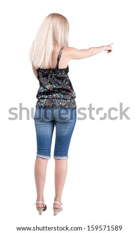 Back view of  pointing woman. beautiful blonde girl in jeans.  Rear view people collection.  backside view of person.  Isolated over white background. - stock photo