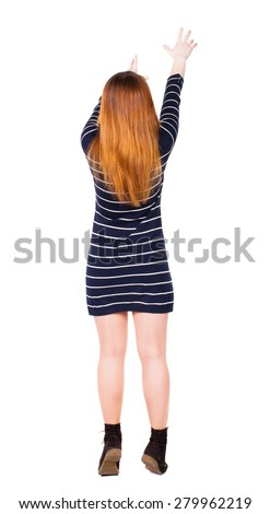 Back view of  pointing woman. beautiful girl. Rear view people collection.  backside view of person.  Isolated over white background. The girl in a dress with two hands reaching up to the sky - stock photo