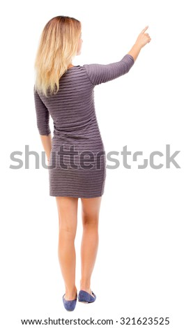 Back view of  pointing woman. beautiful girl. Rear view people collection.  backside view of person.  Isolated over white background. Girl in purple dress shows a finger to the right. - stock photo