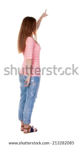 Back view of  pointing woman.Rear view people collection.  backside view of person.  Isolated over white background. Girl in a white T-shirt points a finger at something interesting - stock photo