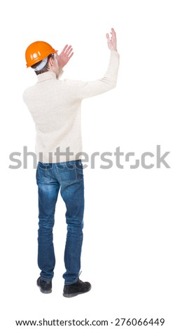 Back view of  pointing young men in helmet. Young guy  gesture. Rear view people collection.  backside view of person.  Isolated over white background. Foreman beckoning someone to her. - stock photo