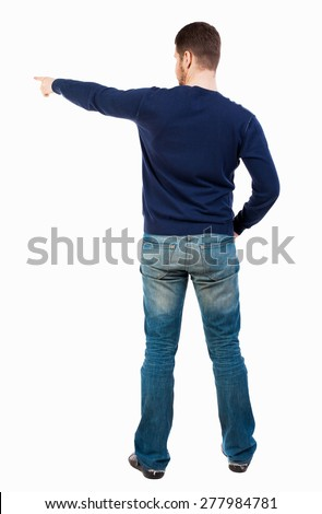 Back view of  pointing young men in jeans. Young guy  gesture. Rear view people collection.  backside view of person.  Isolated over white background. A bearded man in a blue jacket pointing to right  - stock photo
