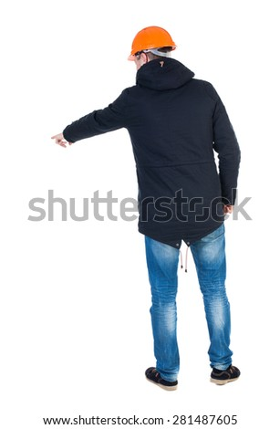 Back view of  pointing young men in parka and helmet. Young guy  gesture. Rear view people collection.  backside view person.  Isolated over white background. Young engineer specifies left hand down  - stock photo