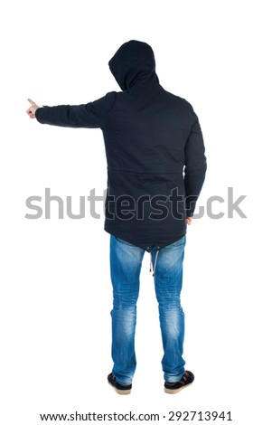 Back view of  pointing young men in parka. Young guy  gesture. Rear view people collection.    Isolated over white background. Man in warm jacket hood pulled on his head is and points to the left.  - stock photo