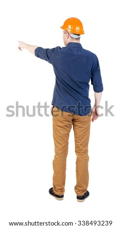 Back view of  pointing young men in  shirt and helmet. Young guy  gesture. Rear view people collection.  backside view of person.  Isolated over white background. - stock photo