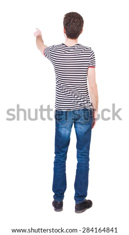 Back view of  pointing young men in  shirt and jeans. Young guy  gesture. Rear view people collection.  backside view of person.  Isolated over white background. Curly French shows a finger.