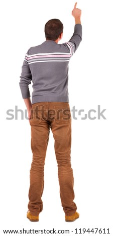 Back view of  pointing young men in  sweater and jeans. Young guy  gesture. Rear view people collection.  backside view of person.  Isolated over white background. - stock photo