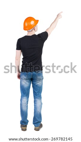 Back view of  pointing young men in  t-shirt and helmet. Young guy  gesture. Rear view people collection.  backside view of person.  Isolated over white background.  - stock photo