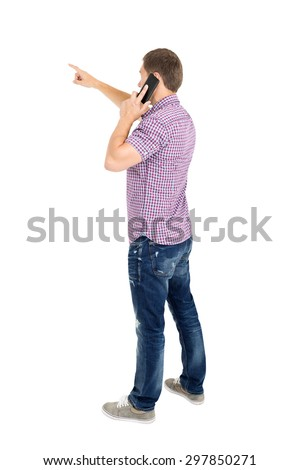 Back view of pointing young men talking on phone. Backside view of person. Rear view people collection. Isolated over white background.  - stock photo