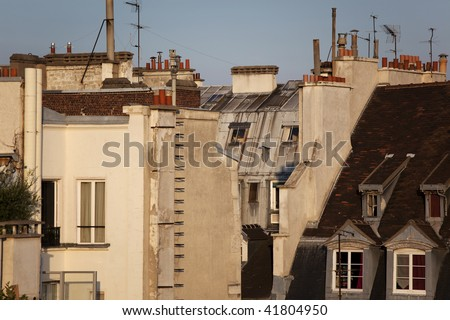 Back view of roof and typical building in Paris - stock photo