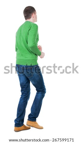 back view of running man in blue pullover. walking guy in motion. Rear view people collection.  backside view of person. Isolated over white background. - stock photo
