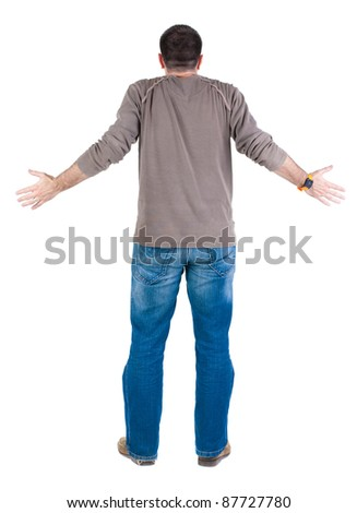 Back view of shocked and scared young  man. Rear view. Isolated over white background.