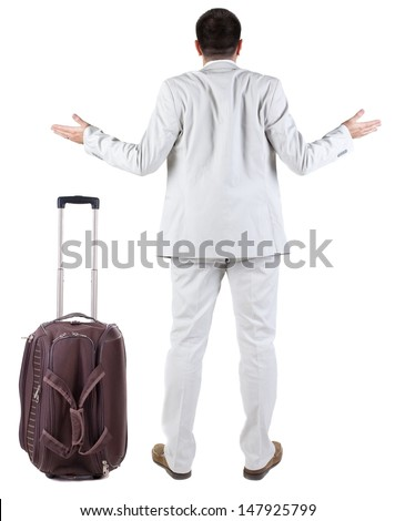 Back view of shocked business man with suitcase looking up. Rear view people collection.  backside view of person.  Isolated over white background. upset businessman