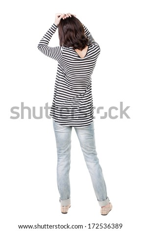 Back view of shocked woman in frock. girl hid his eyes behind his hands.  Rear view people collection.  backside view of person.  Isolated over white background. - stock photo