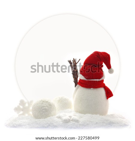 Back view of snowman and Christmas ornaments in front of a paper card - stock photo
