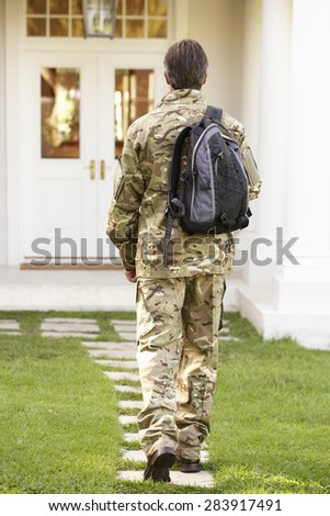 Back View Of Soldier Returning Home - stock photo