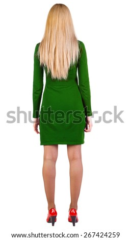 back view of standing beautiful blonde business woman. Young girl in violet dress and red kitten heels. Rear view. Isolated over white background.  - stock photo