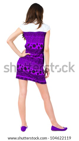 back view of standing beautiful brunette woman. Young girl in purple dress looking ahead of yoursel. Rear view people collection.  backside view of person. Isolated over white background. - stock photo