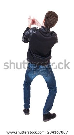 back view of standing man pulling a rope from the top or cling to something.  Rear view people collection.  backside view of person.  Isolated over white background. Crouching guy pulling a rope - stock photo