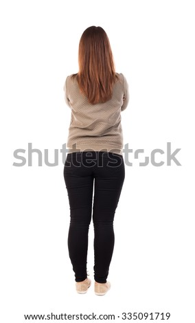 back view of standing young beautiful  woman in jeans. girl  watching. Rear view people collection.  backside view of person.  Isolated over white background.