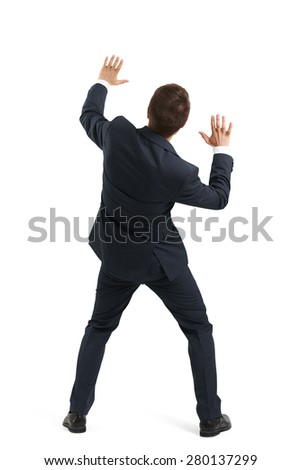 back view of startled businessman in formal wear moving aside and covering hands. isolated on white background - stock photo