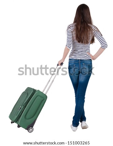 Back view of stylishly dressed brunette woman  with  suitcase looking up.   Standing young girl . Rear view people collection.  backside view of person.  Isolated over white background.