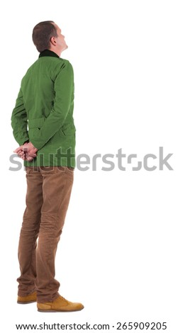 Back view of stylishly dressed man in a brown jackett  looking up.   Standing young guy in jeans and  jacket. Rear view people collection.  backside view of person.  Isolated over white background. - stock photo