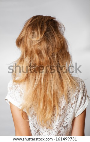 back view of the blond haired female, head and  shoulders shot - stock photo