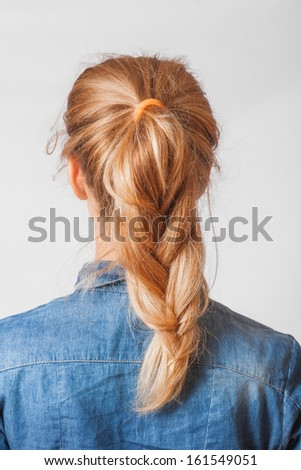 back view of the blond haired female with braid (pigtaile), head and  shoulders shot - stock photo