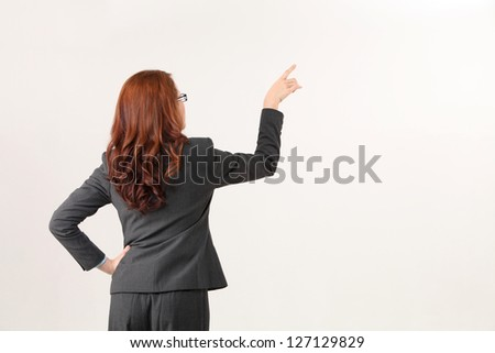 back view of the woman pointing - stock photo